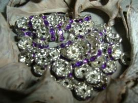 Mooie zilverkleurige spacers met paarse steentjes van 6 mm.