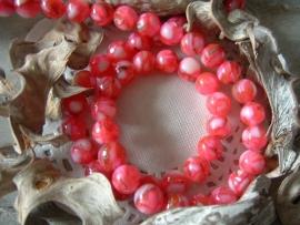Mooie ronde schelpkralen in roze tinten