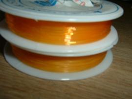 Elastisch nylondraad oranjegeel 0.6 mm.