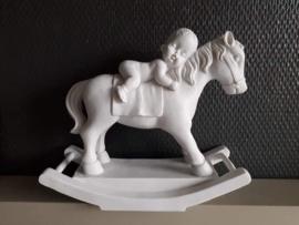 baby op paard