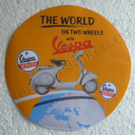 the world on two wheels with vespa sticker