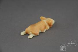 Liggende hond beige/creme