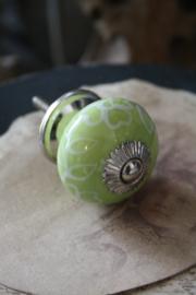fris groen porseleinen knopje