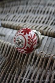 porseleinen kastknop met rode decoratie