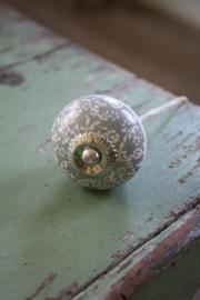 mooie porseleinen knop met grijze decoratie