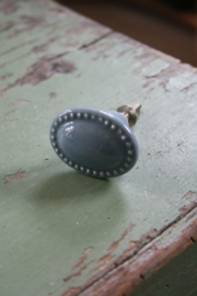 ovale grijs/blauwe porseleinen knop
