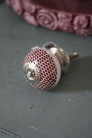 vrolijk kastknopje met roest kleurige stippen