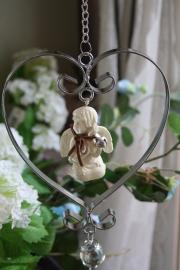 mooie zilverkleurige hanger met porseleinen engeltje