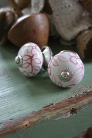 mooi rond kastknopje met rood/oud roze bloemen