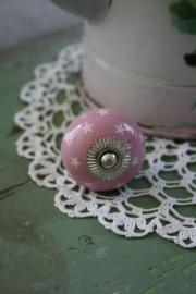 roze porseleinen kastknopje met sterretjes