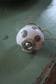 porseleinen knop met grijze stippen