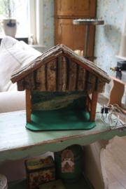 oude houten kerststal met achtergrond