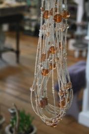 mooie lange ketting van verschillende strengen kralen