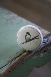 porseleinen knop met vogelafbeelding