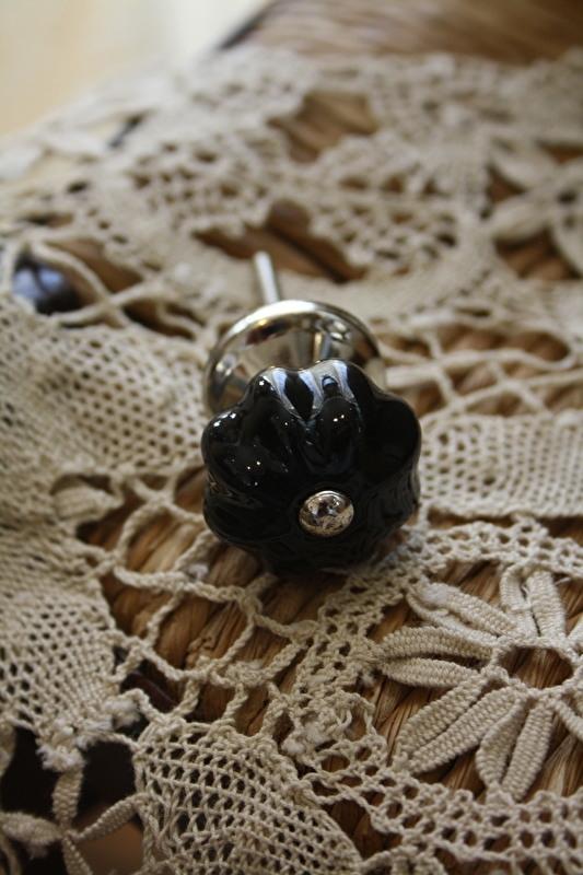 mooi klein zwart porseleinen kastknopje