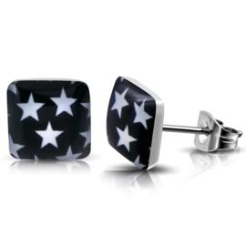 Zilverkleurige chirurgisch staal oorbellen zwart met witte sterren