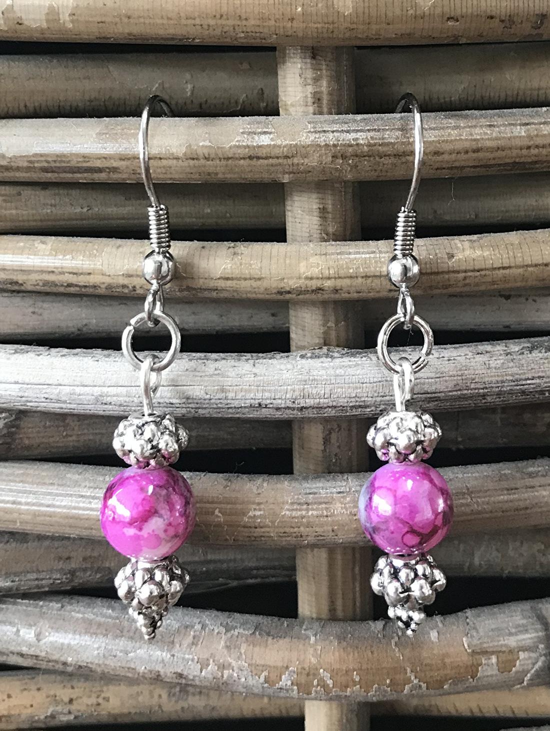 Stalen oorbellen dames met roze detail
