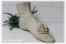 Decoratie schoen met bloem.