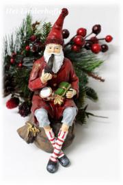 Kerstman zittend *.