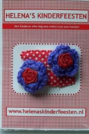 Haarknipjes / rood met witte stip met paars gehaakt bloem en roosje