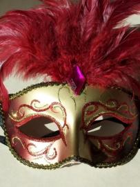 Masker met veren