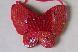 Tasje rood  / vlinder