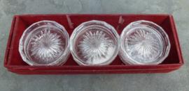 Oude kristal onderzetters van Kristalunie Maastrivht