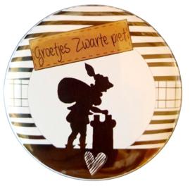 Magneet button 75mm met tekst ''Groetjes Zwarte piet''.