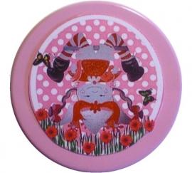 Doosje popje op zijn kop roze.