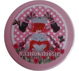 Haarlokdoosje popje op zijn kop roze.