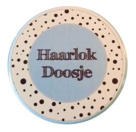 Haarlokdoosje blauw/wit 5cm doorsnee 2 cm hoog.