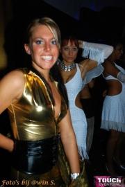 Gouden catsuit met corsetje