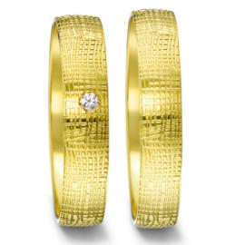 Bolstaande Gouden Trouwringen Set met Speels Patroon en Diamant