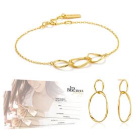 Goudkleurige Swirl Nexus Bracelet + Earrings van Ania Haie + 2x Cadeaubon t.w.v. € 20,00 | Gift Set