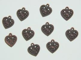 Bedels: Bewerkte hartjes in rood koperkleur (M-076-PH6)
