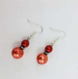 Pareloorbellen in koperoranje en rood, met kristal