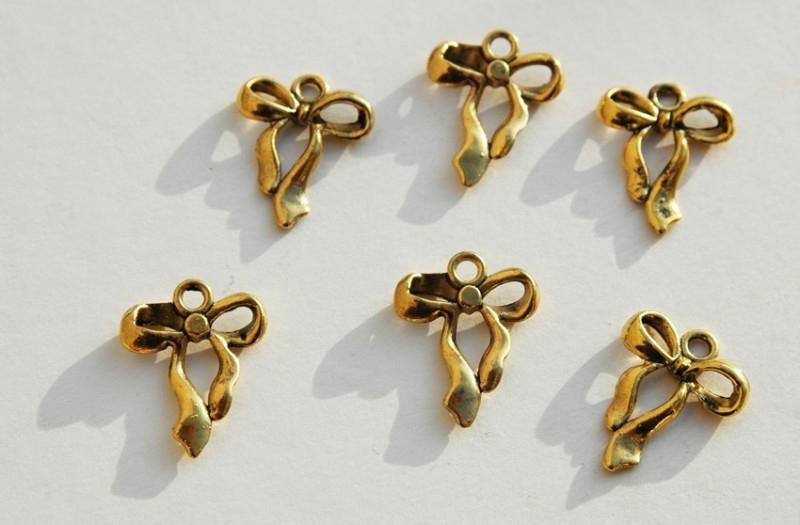 Bedels: gouden strikjes (M-026-PH)