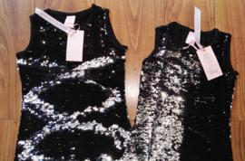 Ge-wèl-dig omkeerbare pailletten jurkje zwart/zilver
