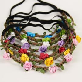 Leuke elastieken haarband met gele roosjes