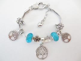 Prachtige Pandora style armband met Tree of Life bedels, klavertjes vier en turquoise kralen