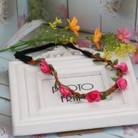 Leuke elastieken haarband met fuchsia roosjes