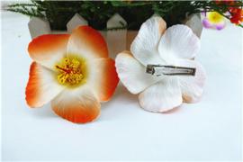 Geweldige Hibiscus Hawaïbloem 9 cm op clip oranje met wit