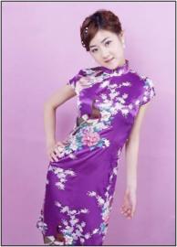 Bijzonder leuk Chinees pauwenjurkje met parelknoopjes paars
