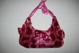 Leuk roze glitterhandtasje met strikken
