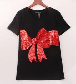 Leuk zwart shirt met grote strik  van pailletten