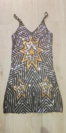 Prachtig dubbelzijdig glitterjurkje gouden/zilveren sterren maat 36/38