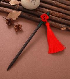 Mooie houten haarpin met rood roosje en kwastje