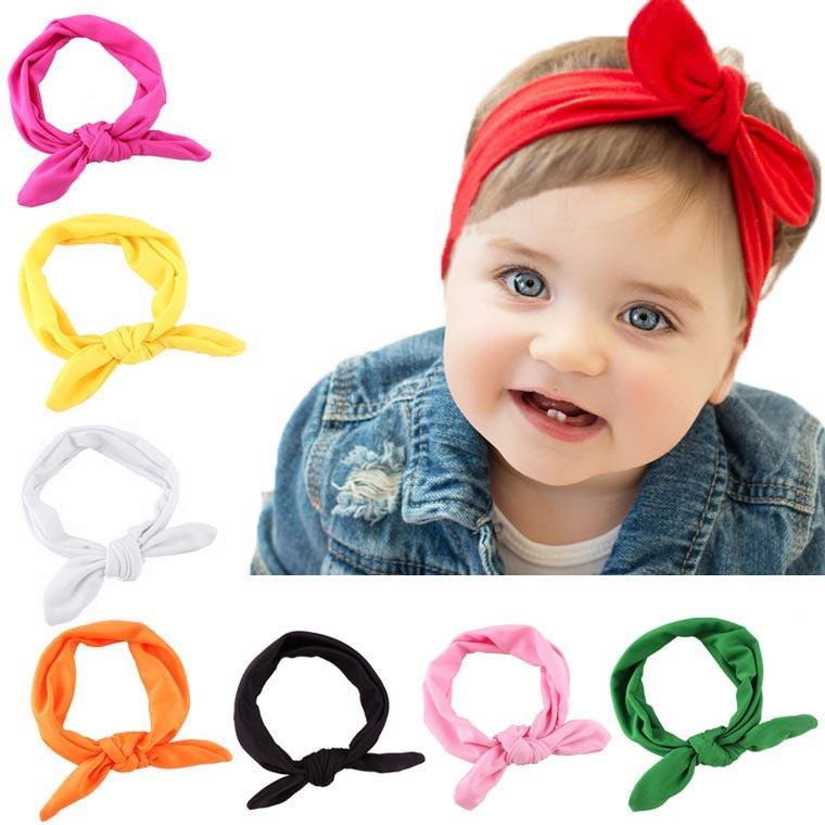 Superleuke haarband met strik effen rood kindermaat