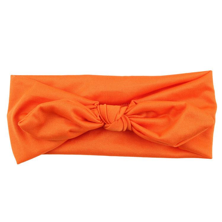 Superleuke haarband met strik effen oranje kindermaat
