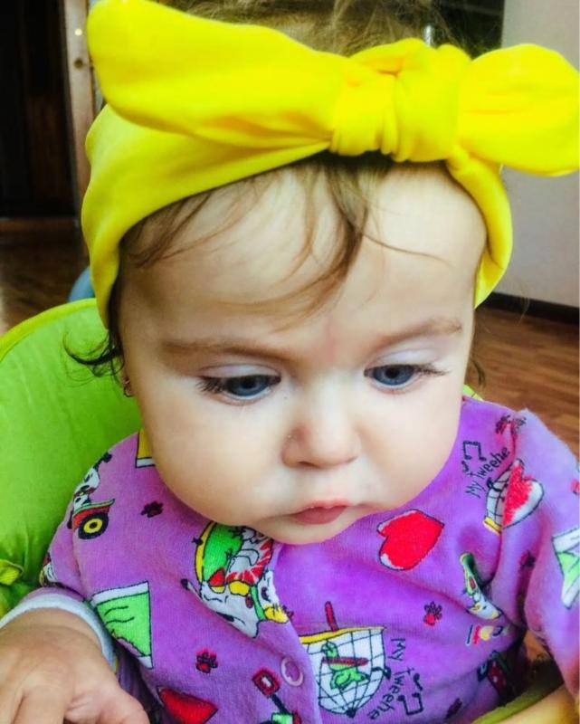 Superleuke haarband met strik effen geel kindermaat